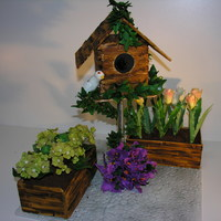 Birdhouse With Tulips Hydrangers And Bouganvilllia   Birdhouse with tulips, hydrangers and bouganvilllia