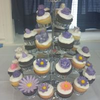 Vanilla And Chocolate Cupcakes With Vanilla Buttercream. I did 50 cupcakes all with flowers.