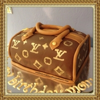 Lv Purse Made With Modeling Chocolate And Fondant Taste Like A Tootsie Roll So Good Logo Was Made With The Foam Stamps I Made A Few Months... LV purse made with modeling chocolate and fondant taste like a tootsie roll so good! Logo was made with the foam stamps i made a few months...