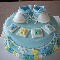 Baby Boy Cakes Welcome to the world little Tane! Chocolate cake covered in fondant with fondant shoes.Clothes were hand cut.. what a mission but oh so...