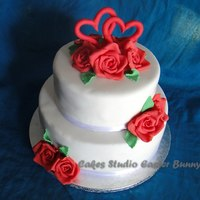 Red And White Wedding Cake. Two tiers of chocolate cake with chocolate mousse.