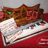 Happy 50Th Birthday To You!   This cake is for my sister's 50th Birthday. We grew up playing piano and flute duets together! It is 100% edible!