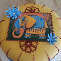 Elephant Henna Cake red velvet cake, creamcheese buttercream filling and piping. Edible paper image.