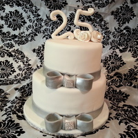 Silver Bling Birthday vanilla rum cake with vanilla buttercream and fondant. number and flowers made with gumpaste