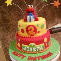 Elmo Birthday Cake Vanilla cake with vanilla pudding filling. Fondant over buttercream. Elmo and present were also made with fondant.
