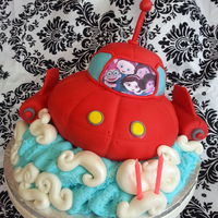 Little Einstein's Birthday Cake chocolate cake with coconut buttetcream, coveted in fondant. added cropprd photo of birthday girl to the image of the little einsteins.