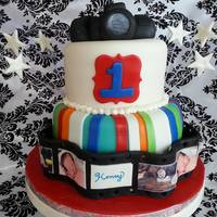 """in A Flash"" Camera Cake  *two tier chocolate and vanilla with vanilla pudding filling. Camera and film strip made fully with fondant mixed w tylose. photos made..."