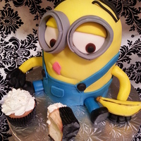 Dispicalble Me - Minioncake  The bottom halfischocolate with chocolate/almond buttercream and the top half is coconut cake with coconut buttercream. Covered all in...