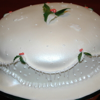 Christmas Cake Chocolate Fudge Cake, with Raspberry Mousse filling, covered with White Chocolate Marshmellow Fondant