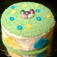 Easter   lemon flavored buttercream frosting with fondant flowers and bunnies