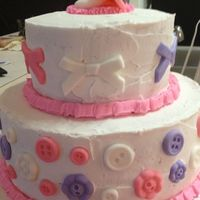 Buttercream Frosting With Fondant Pacifer Bows And Buttons   buttercream frosting with fondant pacifer, bows, and buttons