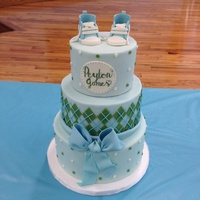 Blue And Green Baby Boy Shower Cake Gumpaste Shoes Handpainted Name Frame Gumpaste Bow Modeling Chocolate Argyle Pattern   Blue and green baby boy shower cake. Gumpaste shoes. Handpainted name frame. Gumpaste bow. Modeling chocolate argyle pattern.