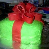 This Was A 8 3 Layer Vanilla Cake The Green Is Bc Icing And The Red Bow Is Mm Fondant To Make The Darker Redi Used Cocoa Powder This was a 8' 3 layer vanilla cake. The green is bc icing. And the red bow is mm fondant. To make the darker red,I used cocoa powder...