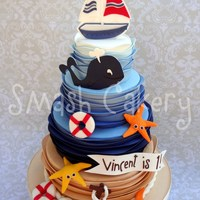 Nautical First Birthday Cake All fondant with fondant and gumpaste figurines- used the wave tutorial that Lesley with Royal Bakery posted on Craftsy, to create the wave...