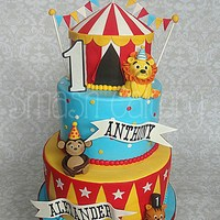 Circus First Birthday Cake Circus First birthday cake, with big top tier, fondant bunting, fondant animal figurines, and gumpaste lettering.