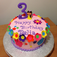 Dora Birthday Cake Lemon cake with raspberry filling. Buttercream with fondant flowers, gumpaste 3. First paid cake!