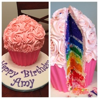 Giant Rainbow Cupcake Cake For my step-daughter's 9th birthday. Cupcake liner is made of candy melts.