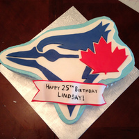 Lindsay's Blue Jays Cake Chocolate cake with Bailey's buttercream filling. Covered in buttercream, decorations are hand-cut fondant.