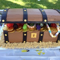 Treasure Chest Birthday Cake  Finished cake. Bottom is chocolate cake with toasted marshmallow filling, lid is rice krispie treats, sand is brown sugar. Details are...