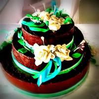 My First Attep To Make A Wedding Cake :) made this ganache wedding cake for my niece. :).. used no cutters or tools.