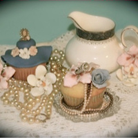 "Inspirational Challenge ""vintage Cupcake"" White Cupcake with Fondant and Gum paste flowers, Fondant Hat, accented with vintage jewelry along with china piece."