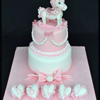 Baby Girls Pink 2 Tier Christening Cake With Handmade Rocking Horse Figure Baby Girls pink 2 tier Christening cake with handmade rocking horse figure