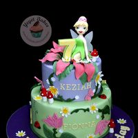 Tinkerbell Enchanted Flowers Theme Cake  An alternative to petal dust and airbrush is colored chocolate powder which I used here for the flower petals; for the wings, edible wafer...