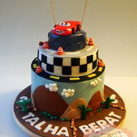 Lightning Mcqueen Cake Three tiered Lightning McQueen themed birthady cake ; Chocolate, Orange, Blackberry and Banana with pastry creme filling.