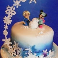 Elsa & Minnie Build A Snowman X A Chocolate Sponge with Chocolate Buttercream, the cake is covered in Sugarpaste and Models made from modelling paste This cake was for 2...