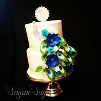 Beautiful Peacock Wedding Cake All Covered In Buttercream With Fondant Topperpeacock Feathers And Flowers beautiful Peacock wedding cake, all covered in buttercream with fondant topper,Peacock, feathers and flowers