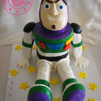 Buzz Lightyear Buzz Lightyear cake. Head, arms and feet are rice crispy treats. Body and legs are cake. Based on the fantastic tutorial from Tasty Cakes...