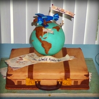 The World Awaits You...world Traveler Baby Shower Suitcase Cake And Globe Cake Pops All handmade and hand painted fondant details.