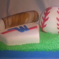 Little Leauge Baseball Cake Made a White Cake with a Rootbeer Buttercream to keep with the baseball theme. Rice Krispy bat, Cake Ball, Cake Base, on top of a sheetcake...