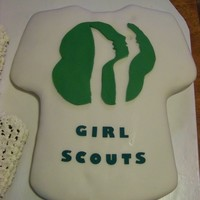 Girl Scout Badge Ceremony Girl Scout T-shirt cake covered in fondant and sugar sheet letter.