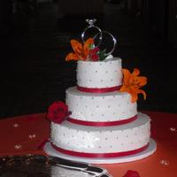 Wedding Cake With Red Ribbon And Silver Dragees Wedding cake with red ribbon and silver dragees
