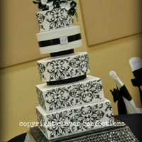 Black & White Damask Wedding Cake A design I've done two other times, this ones featuring 5 tiers (8-10-12-14-16), all buttercream with black buttercream stenciling,...