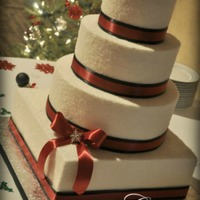Holiday Wedding Cake 6-9-12-14 buttercream tiers encrusted with sugar crystals for a wintery wonderland effect! Real satin ribbon and crystal snowflake accents...