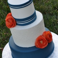 A Collection Of Wedding Cakes 6-9-12 (tall top and middle tier), top tier is buttercream with navy fondant stripes, middle tier is buttercream encrusted with sugar and...