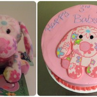 Buttercream Transfer Cake Beside The Picture Of The Birthday Girls Favorite Stuffed Animal   Buttercream transfer cake beside the picture of the birthday girl's favorite stuffed animal.