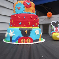 Mickey Mouse Clubhouse Cake Three tiers, double layers. Iced with buttercream and covered in MMF. Has fondant and buttercream details. Would like feedback from peer...