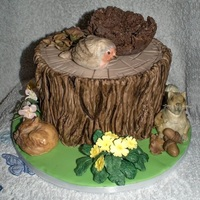 Tree Stump Animals made from fondant and coloured in colour dusts and birds nest made from chocolate and shreddedwheat.