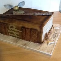 Harry Potter Book Of Spells Vanilla sponge covered in buttercream and fondant and airbrushed.