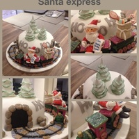 Santa Express 9inch fruit cake, trees, Santa , track and toy sack all made from 50 50 fondant / flower paste and train made from flower paste alone.