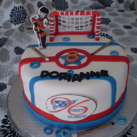 Ringette Ringette cake I've made for my niece's 8th birthday. Handmade fondant net and edible picture for her team logo and the little...