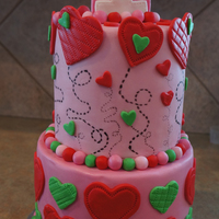 Heart Themed First Birthday Cake This was my third fondant cake. First tier is vanilla bean with vamilla bean SMBC second tier is strawberry with strawberry SMBC. Fondant...