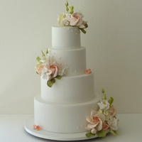 Romance Wedding Cake  I was searching for an elegant yet simple wedding cake idea. Classic form is to deliver a universal wedding look and sugar flowers will add...