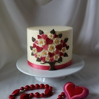 Hand Cut Love Tree Buttercream cake with marzipan hand cut decoration.