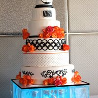 First Wedding Cake With Glass Block Colour Changing Stand * This 6 tiered cake is a mix of chocolate mud and white chocolate mud cakes. All covered in chocolate ganache, then fondant. Made the...
