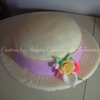 Sun Hat  Sun Hat Birthday Cake. Everything seen is 100% edible. The hat has basket weave finish and the ribbon was embedded with some stitching....
