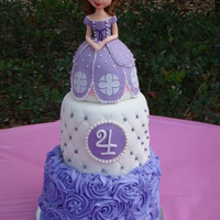Sofia The First Birthday Cake Sofia the First cake for my daughter, Sophia's 4th birthday. Topper sculpted from rice treats and fondant. Bottom tier buttercream...